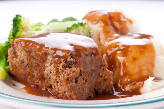 delicious meatloaf with mashed potatoes, gravy and fresh vegetab