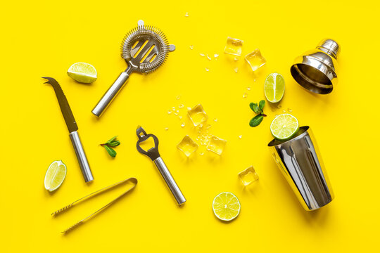 Mojito cocktail set with bar tools and utensils with lime and mint, flat lay
