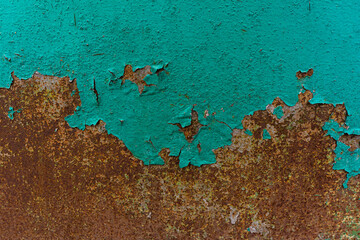 surface of a rusty old sheet with decaying green paint.