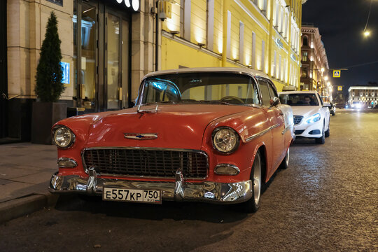 Red Chevrolet bel air 1955 on night streets of Saint-Petersburg. Hot-rod car concept. 02.10.2017 Saint-Petersburg, Russia.
