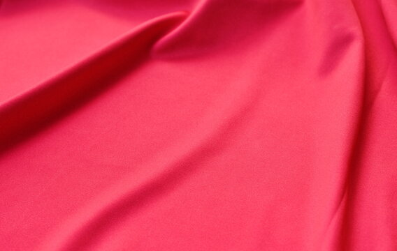 close up of red fabric texture and background