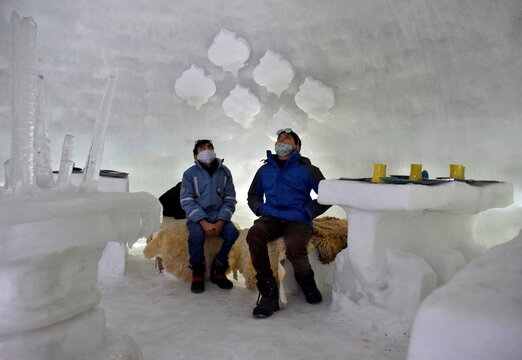 """Tourists look at the ceiling of """"Igloo Cafe at Gulmarg"""