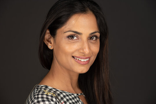 Headshot of beautiful Asian Indian woman smiling.