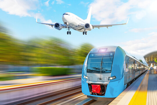 Passenger suburban train at the airport station and landing plane in the sky.