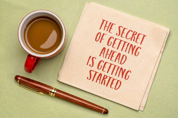 the secret of getting ahead is getting started - inspirational handwriting on a napkin with a cup of coffee, business, education and personal development concept