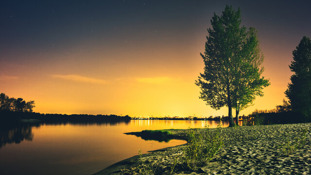 Night landscape on the Dnieper river, view of Kiev