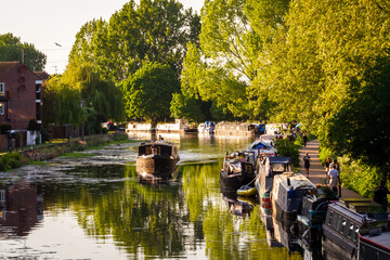 Fototapeta London, Uk, 26th of April, 2020: Twilight on the river Lee in Hackney