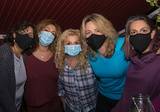 Portrait Group Of Young Happy Friends Wearing Face Mask During Covid