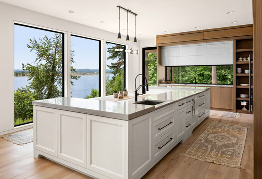 Beautiful kitchen in new luxury home with large island and water view