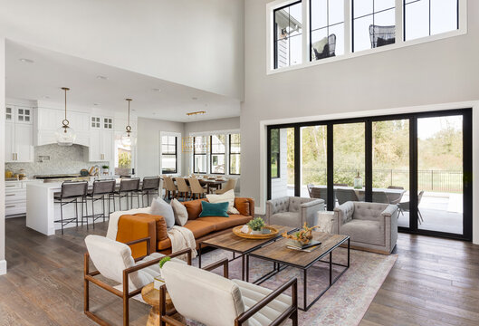 Living room and kitchen in new farmhouse style luxury home