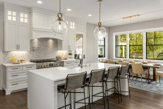 Kitchen in New Modern Farmhouse Style Luxury Home with Lights On