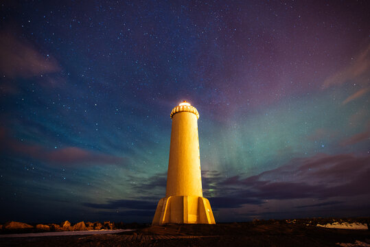 Lighthouse in Akranes Iceland with colorful clouds and northern lights