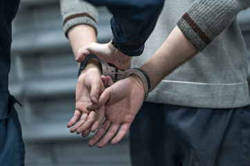 handcuffing the arrested person. Implementation of the arrest - fototapety na wymiar