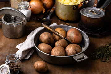 Raw uncooked potato in old vintage pot