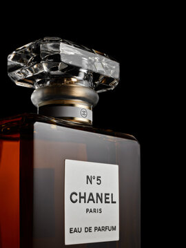 Bottle of perfume Chanel № 5. on black background. Coco Chanel