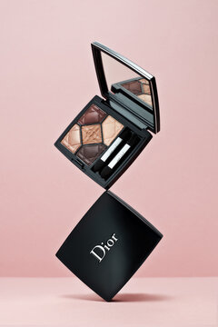 Eye shadow palette Dior 5 couleurs couture on pink background. Christian Dior