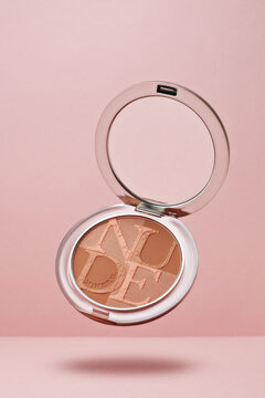 Palette of powder Diorskin mineral nude bronze on pink background. Christian Dior
