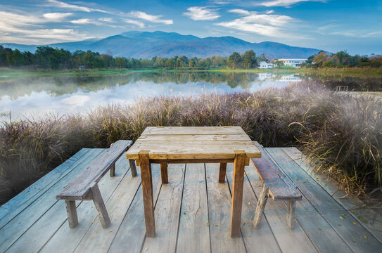 Wooden chairs and table at lake side restaurant  for winter vacation