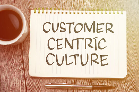 Customer centric culture, text words typography written on book against wooden background, life and business motivational inspirational