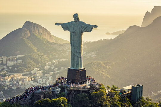 Aerial view of Christ and Sugar Loaf Mountain, Rio De Janeiro, Brazil . People on the top of Corcovado Hill