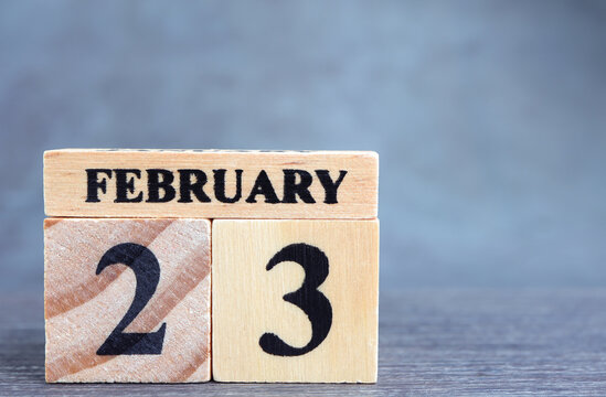Day 23 of february month, Wooden calendar with date. Empty space for text.