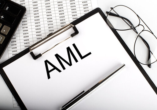 Paper with Anti-money laundering AML on a table