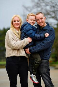 Tom Hayes, his wife Sarah Tighe and son Josh pose for a picture, in Arundel