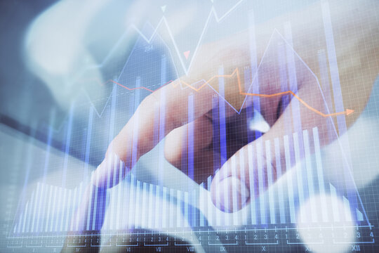 Multi exposure of man's hands holding and using a phone and financial chart drawing. Market analysis concept.
