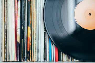 Obraz Close up of vinyl record with records collection - fototapety do salonu