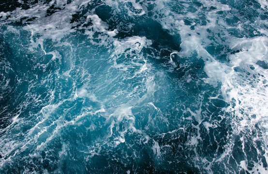 Abstract blue sea water with white wave