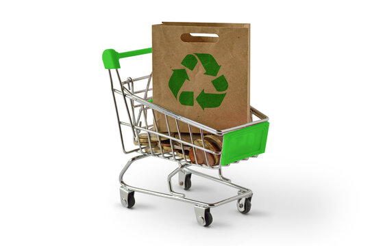 Shopping cart with paper shopping bag with recycle symbol on white background - Ecology concept