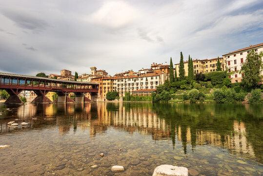 Cityscape of Bassano del Grappa with the Bridge of the Alpini (Ponte degli Alpini or Ponte Vecchio) and the Brenta River. Vicenza province, Veneto, Italy, Europe.