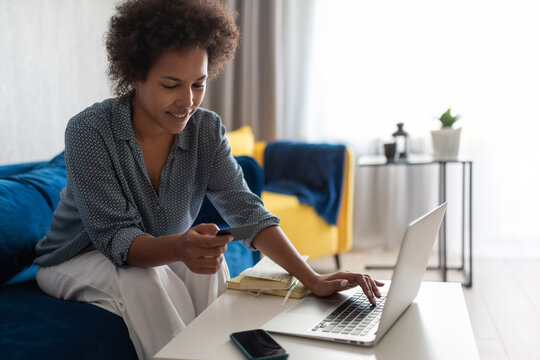 Black woman making online purchases