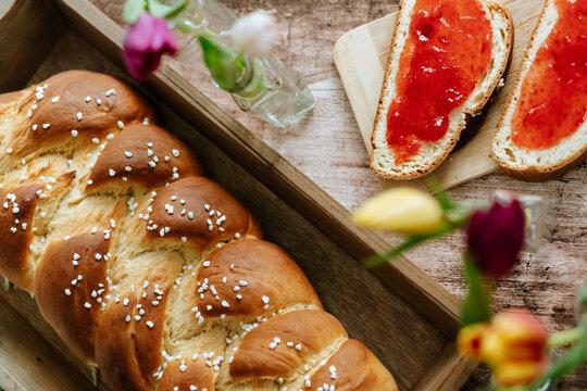Fresh baked sweet braided yeast bun, food, still life