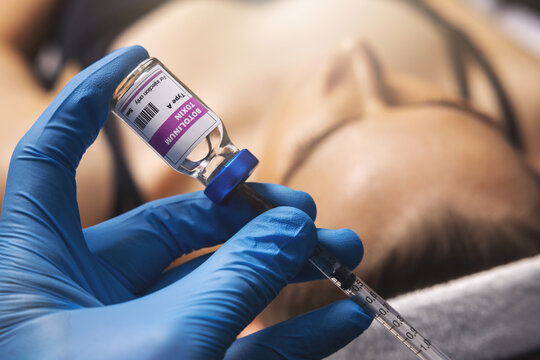 cosmetic botox injection. filling syringe with botulinum toxin