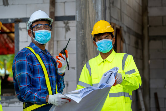 Construction workers wear protective face masks for safety in co