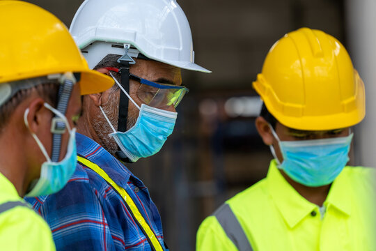 Engineer wearing protective mask to Protect Against Covid-19 at