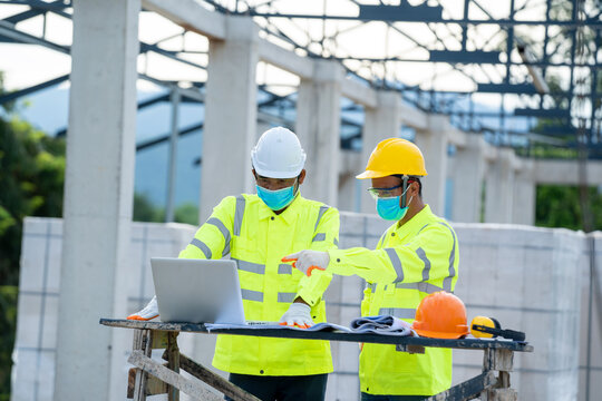 Construction manager and engineer use laptop working about proje
