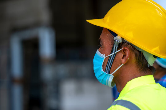 Engineer wearing protective mask to Protect Against Covid-19 and