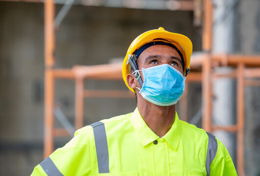 Construction worker wear protective face masks for safety in con