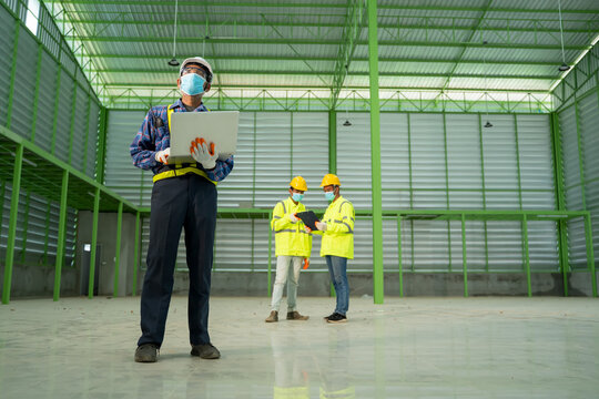 Warehouse worker wearing protective mask to Protect Against Covi