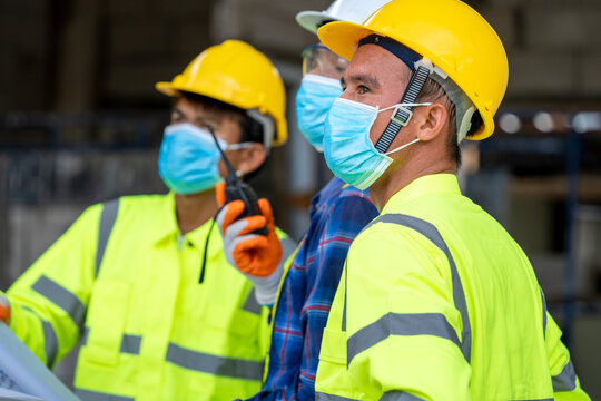 Group civil engineer wearing protective face mask during the ins