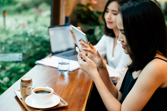 Asia woman using smartphone,mobile phone working,playing with re