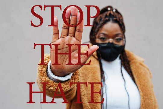 Stop the hate. African american woman, wear black face mask show stop hand sign.