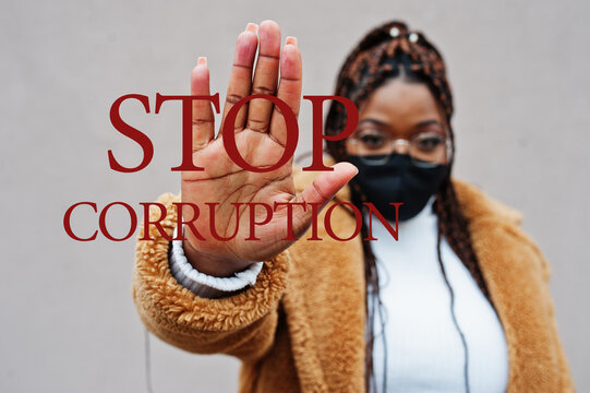 Stop corruption. African american woman, wear black face mask show stop hand sign.