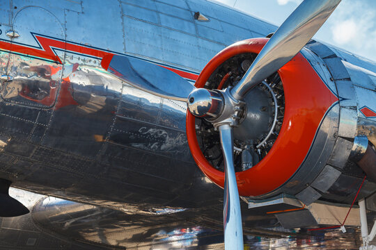 Close up view of a vintage propeller passenger and cargo airplane