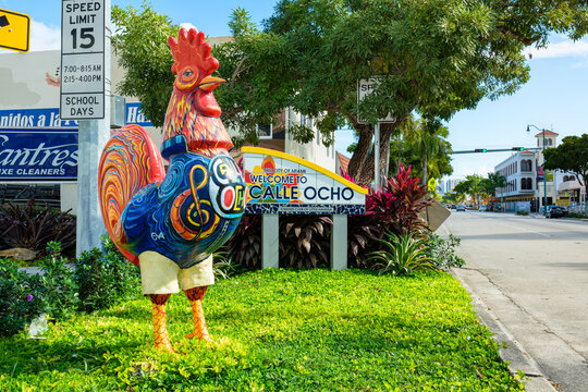Colorful artwork and sign on display at the entrance to the popular Calle Ocho in historic Little Havana in Miami, Florida