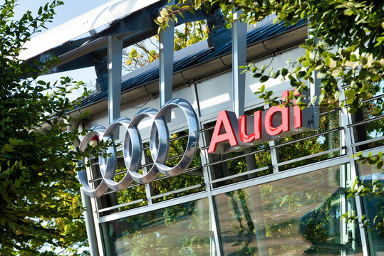 Audi emblem at one of Audi's auto dealerships, Audi is a German automobile manufacturer that designs, engineers, produces, markets and distributes luxury automobiles