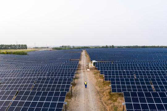 Aerial view of technician in solar farm