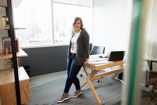 Portrait stylish confident businesswoman in office